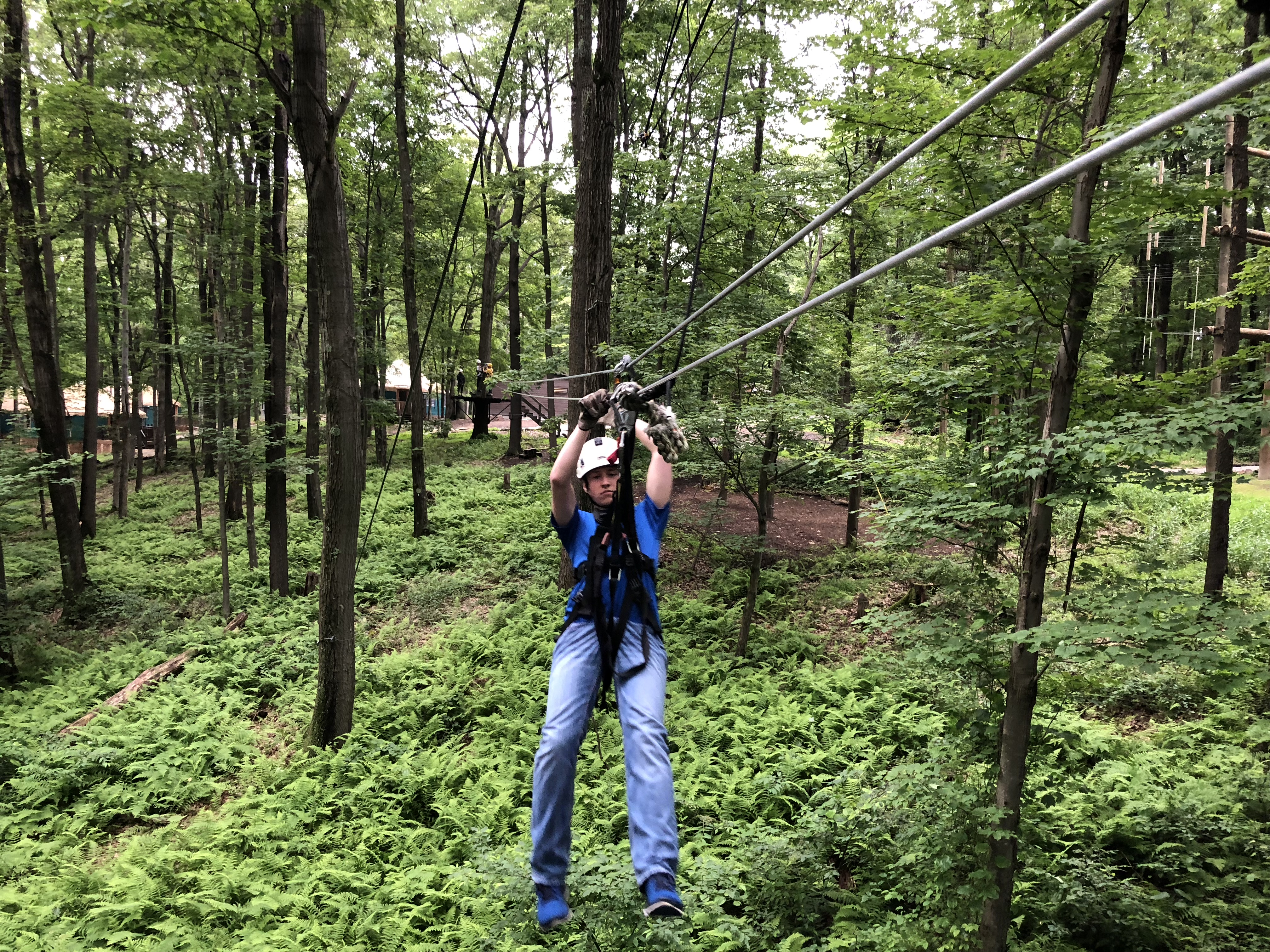 A student completing the zip line tour