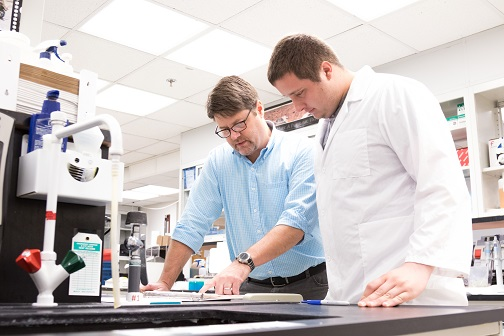 I. Mark Olfert, Ph.D. with student in lab.